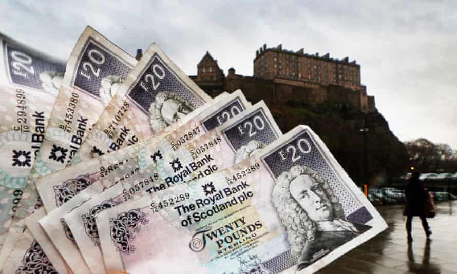 RBS twenty pound notes seen in front of Edinburgh Castle.