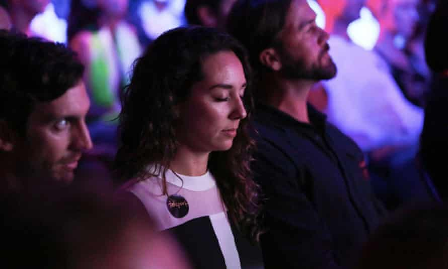 Attendees at Shine clear their minds with meditation.