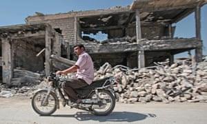 Summer motorcycle ride through the destroyed Syrian border town of Kobani.