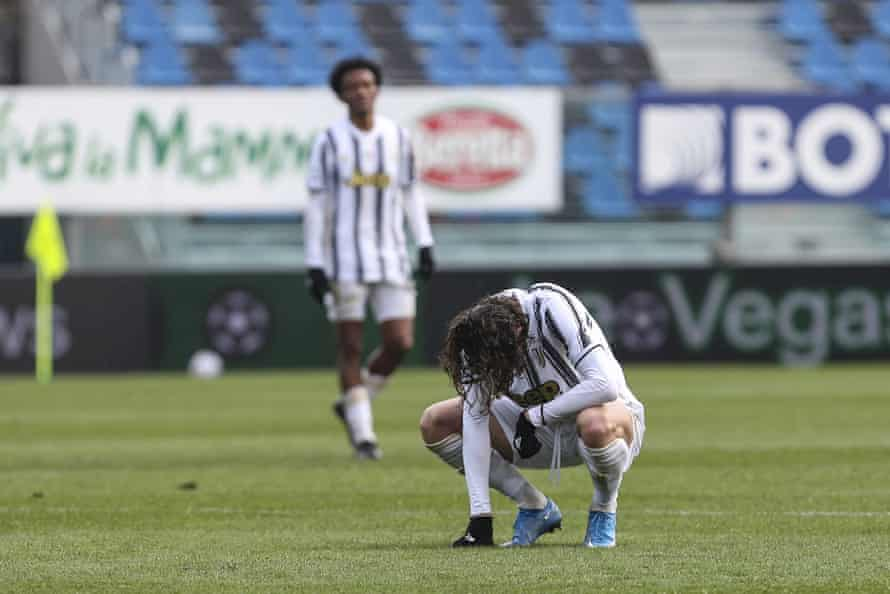 Juventus's Adrien Rabiot squats on the pitch.