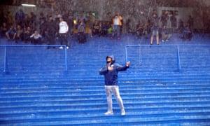 The heavy rain didn't stop this Boca fan getting in the pre-match spirit.
