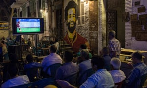 There is near silence in a Cairo coffee-house as locals sit with furrowed brows to watch Mo Salah and Liverpool take on Roma in the Champions League.