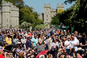 Crowds watch a giant screen broadcasting the wedding ceremony in Windsor