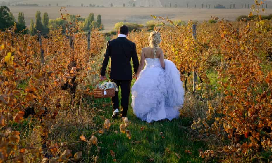 Newlywed couple leaving a vineyard