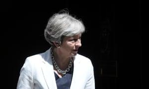 Theresa May waits on the doorstep of No 10.