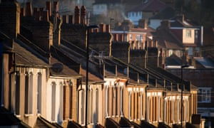 A row of terraced houses bask in the evening sun