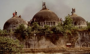 The demolishing of the Babri Masjid mosque in 1992.