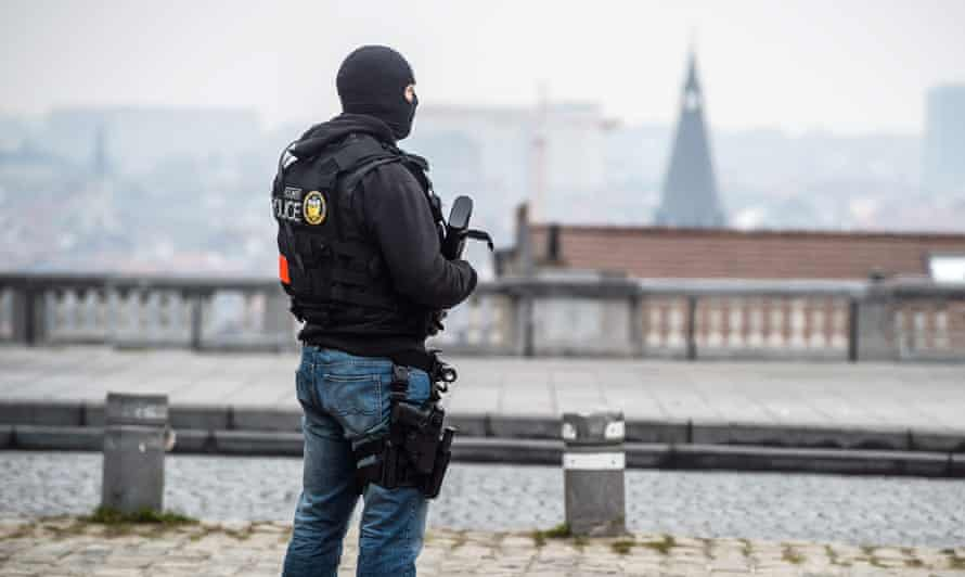 A police officer stands guard in Brussels.