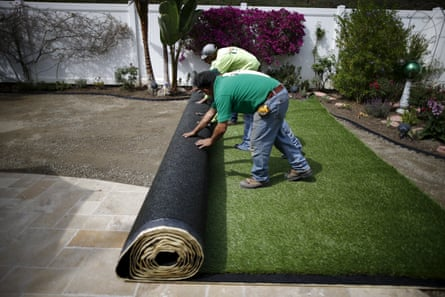 Artificial turf is rolled out after digging up a lawn due to California suffering its worst dry spell in 1,200 years