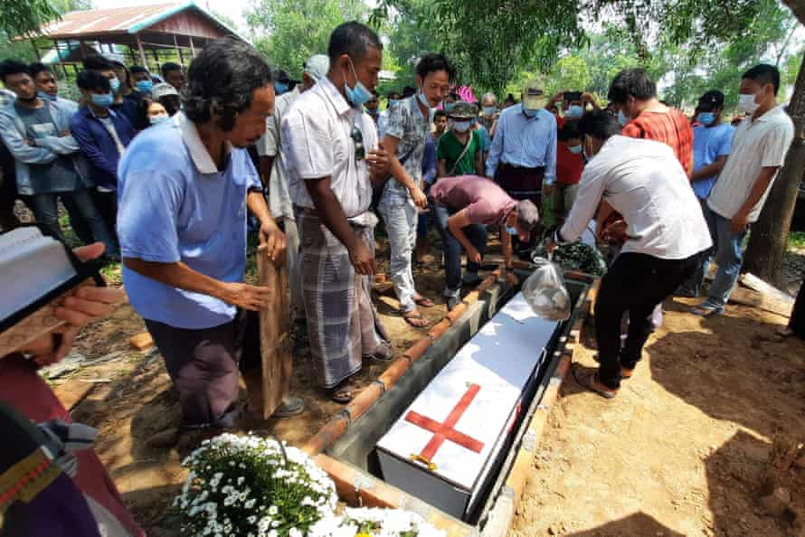 Mourners attend the funeral of Saw Sal Nay Muu, who died after attempting to flee a checkpoint manned by security forces, in Dawei.