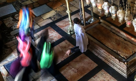A man prays by the Stone of the Anointing at the Church of the Holy Sepulchre.