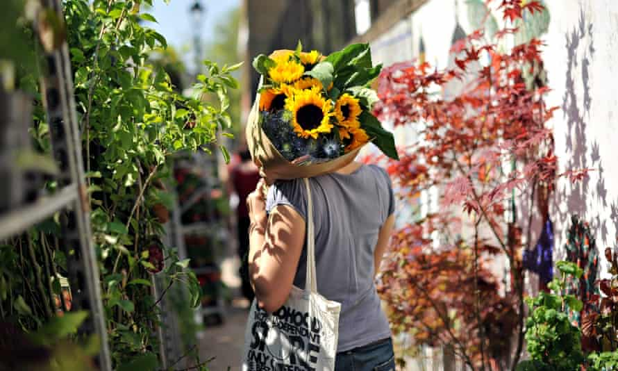 flowers including a big sunflower being delivered