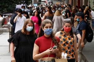 People walk along a busy Bourke Street Mall in Melbourne's CBD.