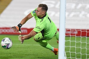 Arsenal keeper Bernd Leno saves Harry Wilson's penalty in the shoot-out.
