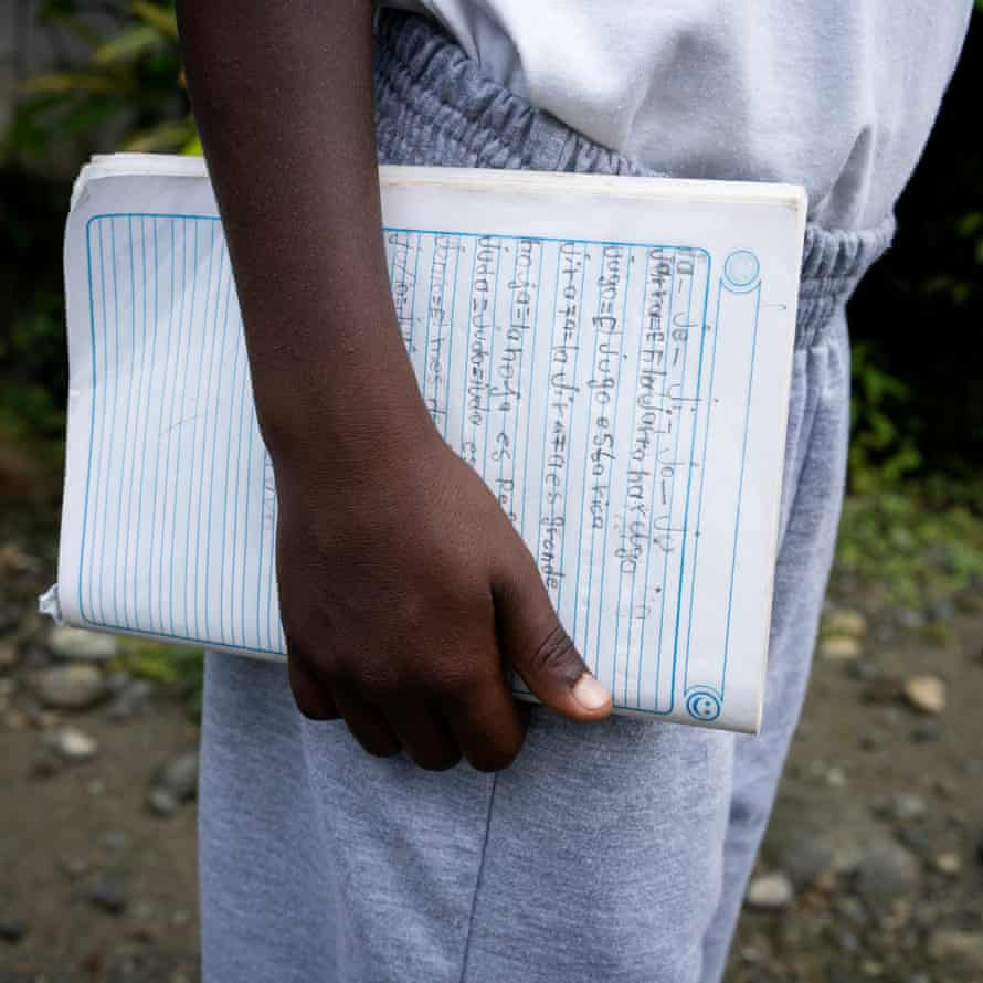 Luis Escobar holds his notebook on his last day of classes at the Playa de Oro community school.