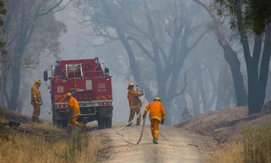 Firefighters attempting to contain a bushfire near Scotsburn on Sunday.