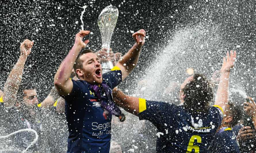 Clermont Auvergne players celebrate with the trophy after winning their first European title in 12 years.