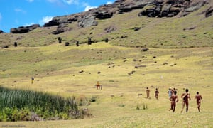 Runners at the Rano Raraku crater, during the triathlon on Easter island