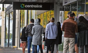 People queue outside a Centrelink office in Melbourne