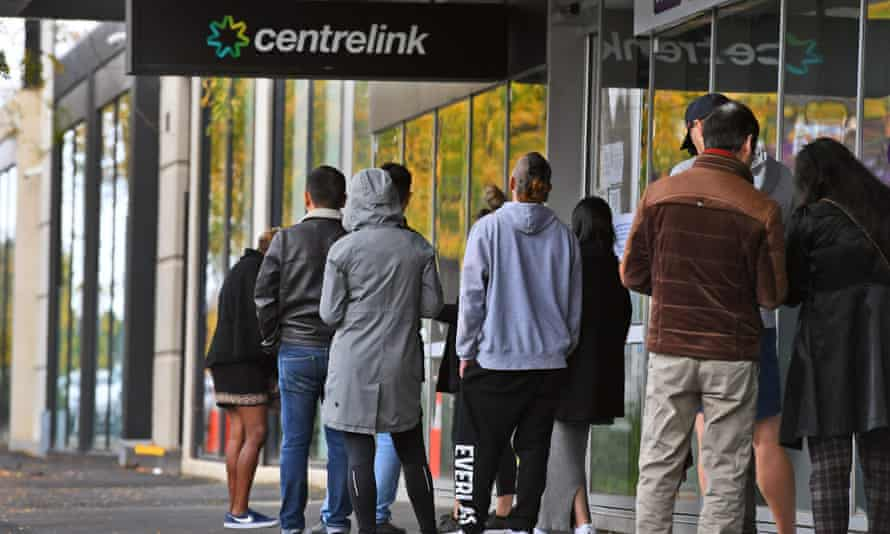 People queue outside a Centrelink office in Melbourne in April