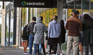 People queue up outside a Centrelink office in Melbourne on April 20, 2020