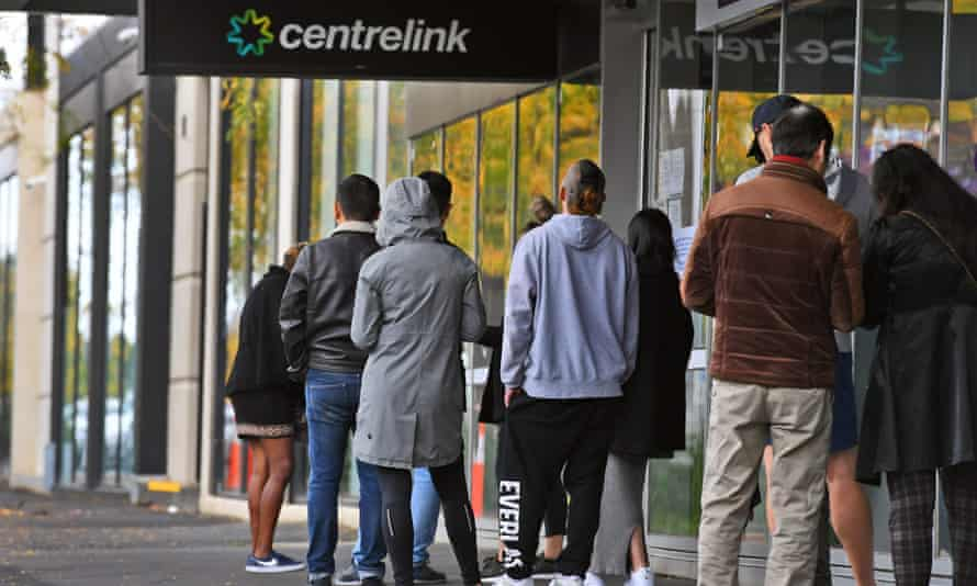 people queue up outside a Centrelink office in Melbourne
