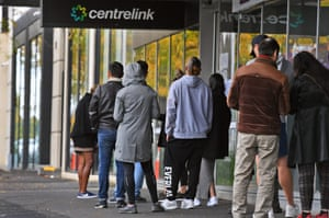 People queue up outside a Centrelink office in Melbourne in April