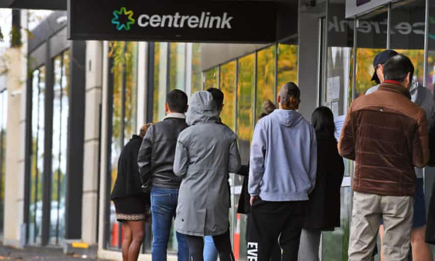 People queue outside a Melbourne Centrelink office