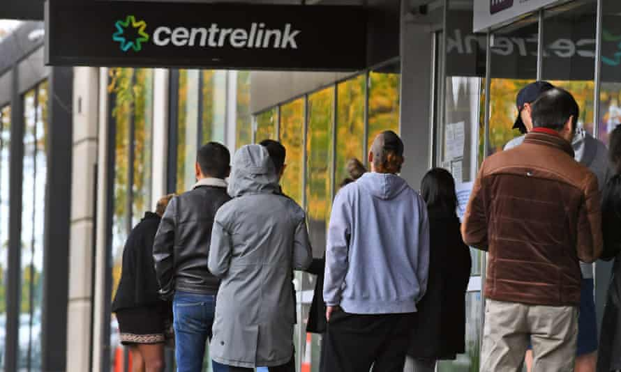 People queue at a Centrelink office in Melbourne