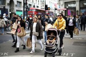 People walk on Oxford Street in London
