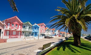 Colorful holiday cottages in the coastal village of Costa Nova, Portugal.
