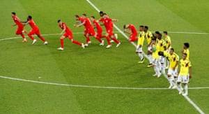 England run to celebrate the moment, as John Stones and Harry Maguire give glancing looks back at the Colombia players.
