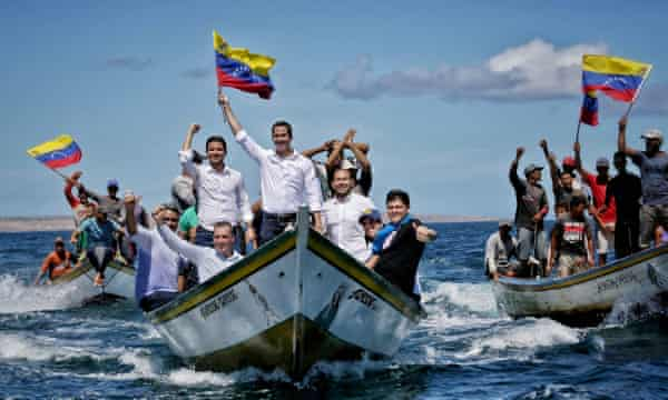 Handout picture released by Guaidó press office of the politician and supporters arriving at one of the islands of Nueva Esparta state, off Venezuela's Caribbean coast.