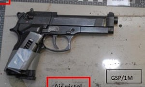 An imitation handgun with an empty magazine strapped to it that was found stashed in Naweed Ali's car.