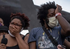 Protester organizers shed tears while speaking during a peaceful march in Detroit
