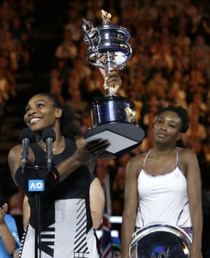 Serena Williams lifts aloft the Daphne Akhurst Memorial Cup for the seventh time.