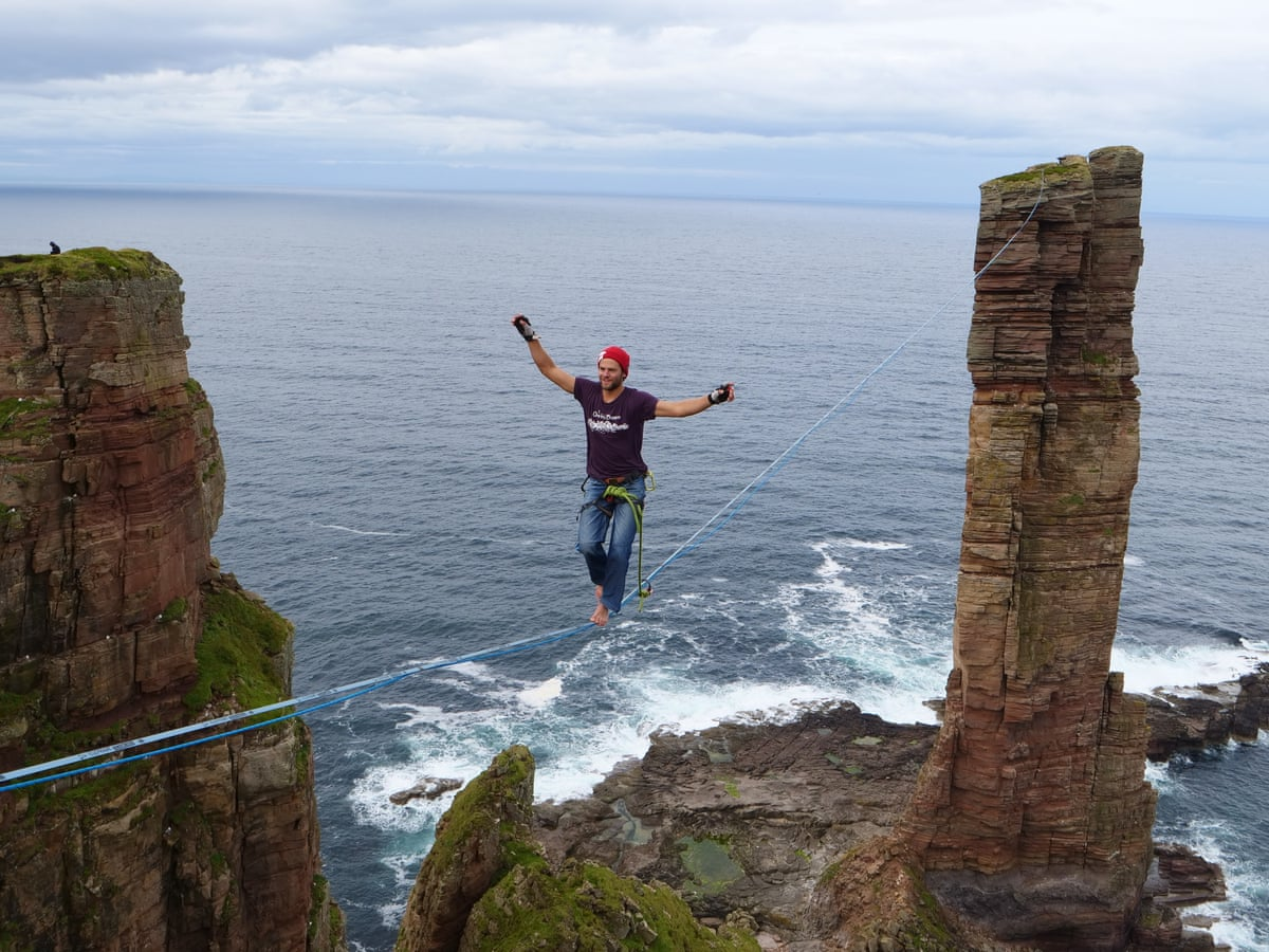 German adventurers perform high-wire walk along Old Man of Hoy | Scotland |  The Guardian