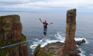 Alexander Schulz has become the first person to high wire walk to the summit of Scotland's Old Man of Hoy - and back.