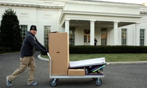 A man moves boxes during U.S. President Barack Obama's last full day at the White House