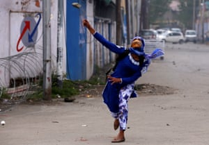 Srinagar, Kashmir A student throws a rock