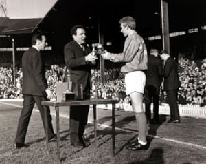 Manchester United striker Denis Law receives his award