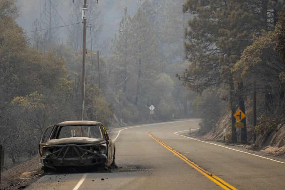 A burnt out vehicle sits on the roadside after the Bear Fire in Feather Falls, California.