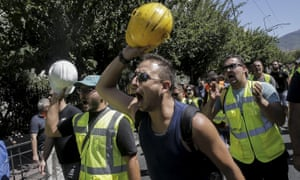 Miners outside the environment ministry in Athens.