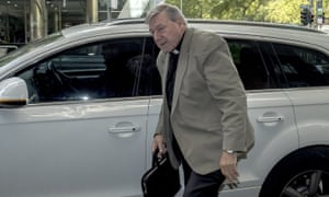 Cardinal George Pell arrives at court on Wednesday