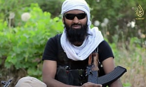 Ruhul Amin appearing in a militant video posted online.