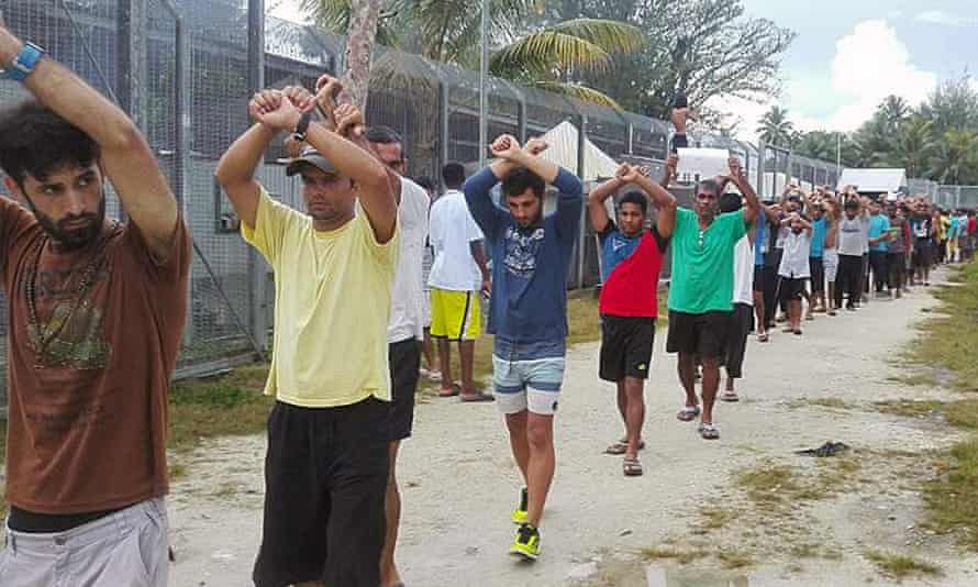 Asylum seekers and refugees protest at the now-closed Manus Island immigration detention centre. Twelve former Australians of the Year have condemned the Coalition government for the standoff there.