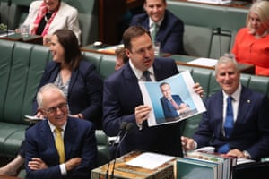 Trade minister Steve Ciobo uses a prop just before he was sat down by the speaker during question time in the house of representatives parliament house Canberra this afternoon. (It is from Bill Shorten's GQ interview)