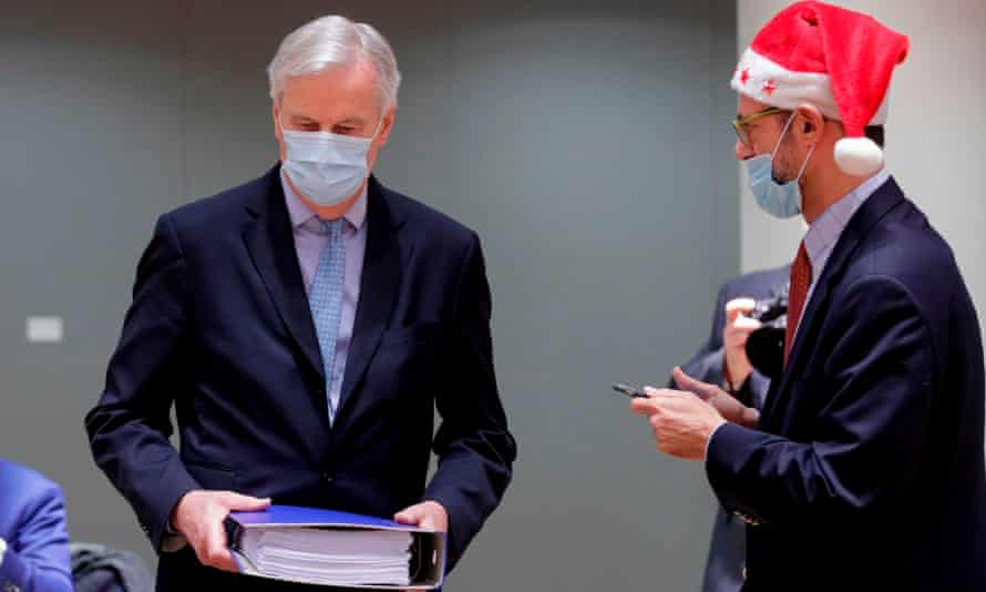 Michel Barnier (left) is watched by a Greek representative as he arrives at a special Christmas Day meeting to brief EU ambassadors on the Brexit trade deal finally struck the previous day.