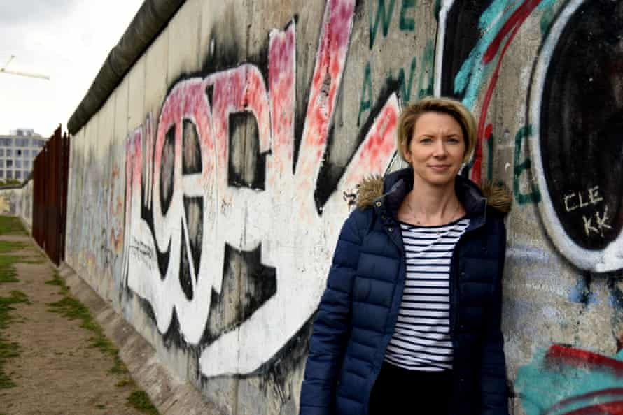'Sure-handed and clear': Tunnel 29 presenter Helena Merriman at the Berlin Wall.
