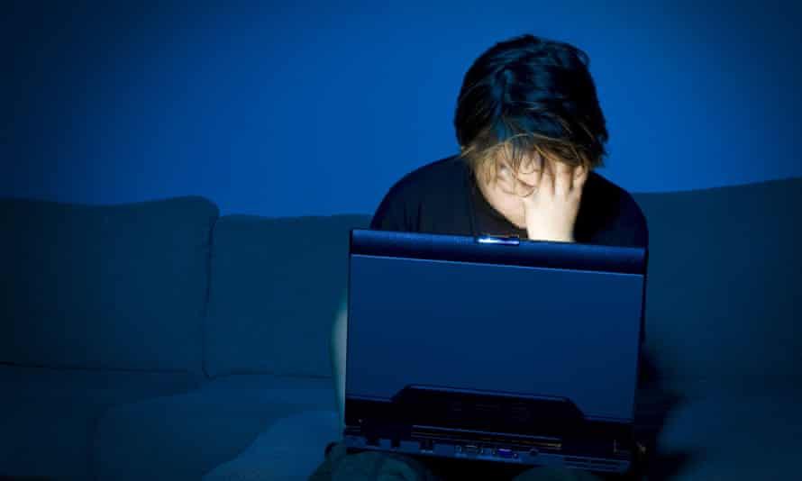 Boy using computer at night